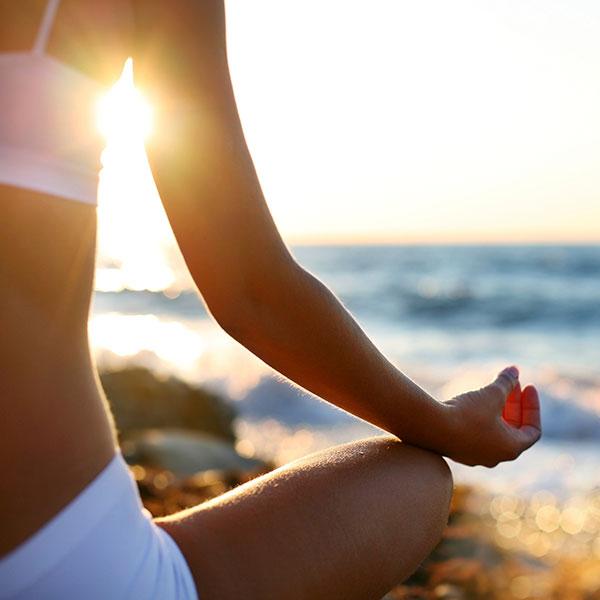 Sunrise vinyasa on the Beach